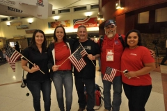 Aera employees who greeted members of the Honor Flight were, from left, Denys Contreras, Jennifer Valdez, Kevin Cowen, Eddie Medrano, and Linda Mohammad.