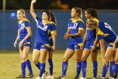 Sabrina Delgado, No. 18, acknowledges the crowd during introductions at the Cal State University Bakersfield soccer match against Seattle. The crowd also featured some of her Aera colleagues.