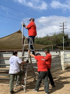 Aera volunteers help prepare the grounds of the Humane Society of Ventura County for fire or other potential disaster.