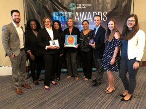 Aera team members display all three GRIT awards in Houston