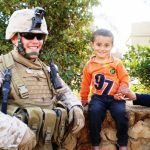 Jake Cosper and Iraqi child -Veterans