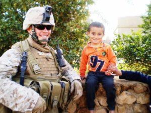 Jake Cosper and Iraqi child -Veterans