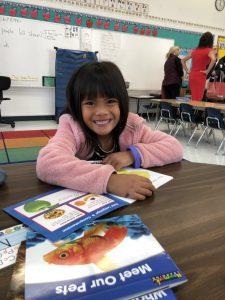 San Ardo kindergartner Coraline Limosnero enjoys new books.
