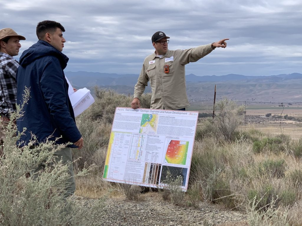 Dallon Stang (right) explains the history of geologic formations at Coalinga's oilfield to students. Stang, who joined Aera in 2013, is a California-licensed professional geologist.