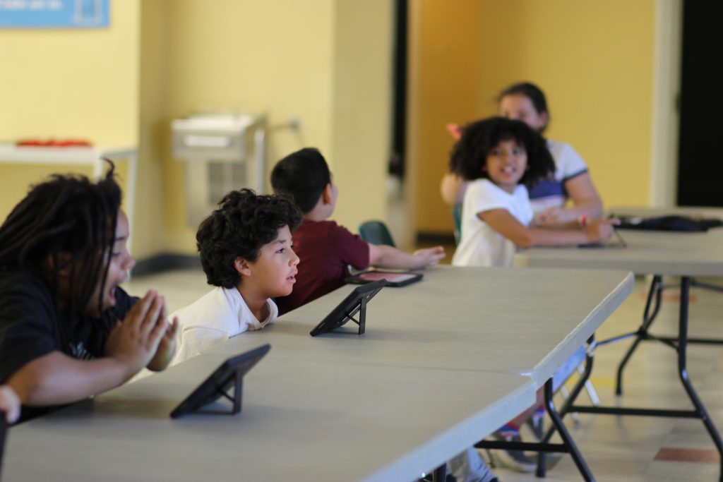 Kids interact during a homework session at the Boys & Girls Clubs of Kern County in April. (Photo: Orlando Trevino)