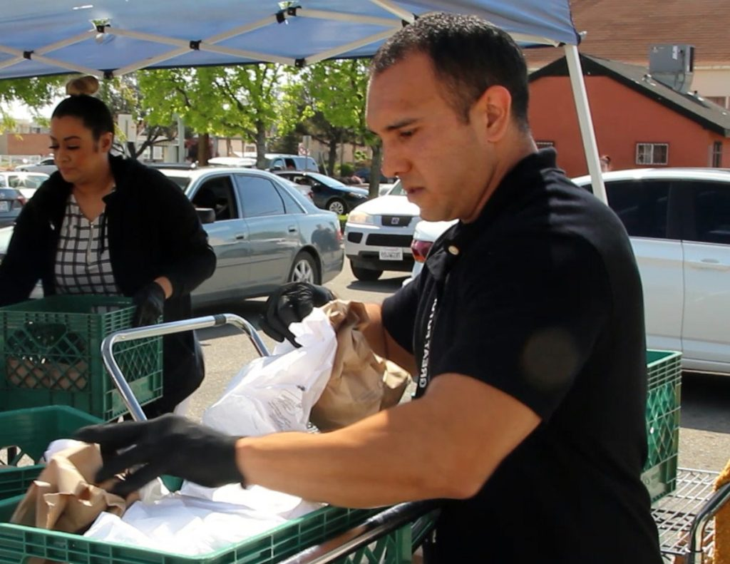 Volunteers with the Boys & Girls Clubs of Kern County distribute food during the COVID-19 crisis. (Photo: Orlando Trevino)