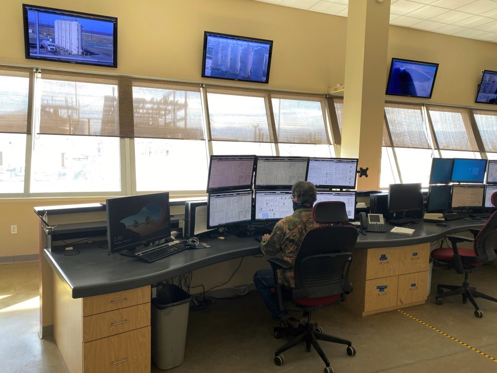 """Although the machines do most of the work, you're juggling a lot of parts,"" says Aera reliability specialist Steve Peart, here operating the control room for the water-softening plant at Belridge."