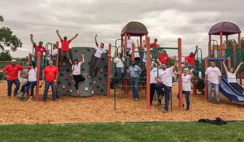 Aera Energy employees celebrate their efforts to improve this playground at San Ardo Elementary School in south Monterey County.