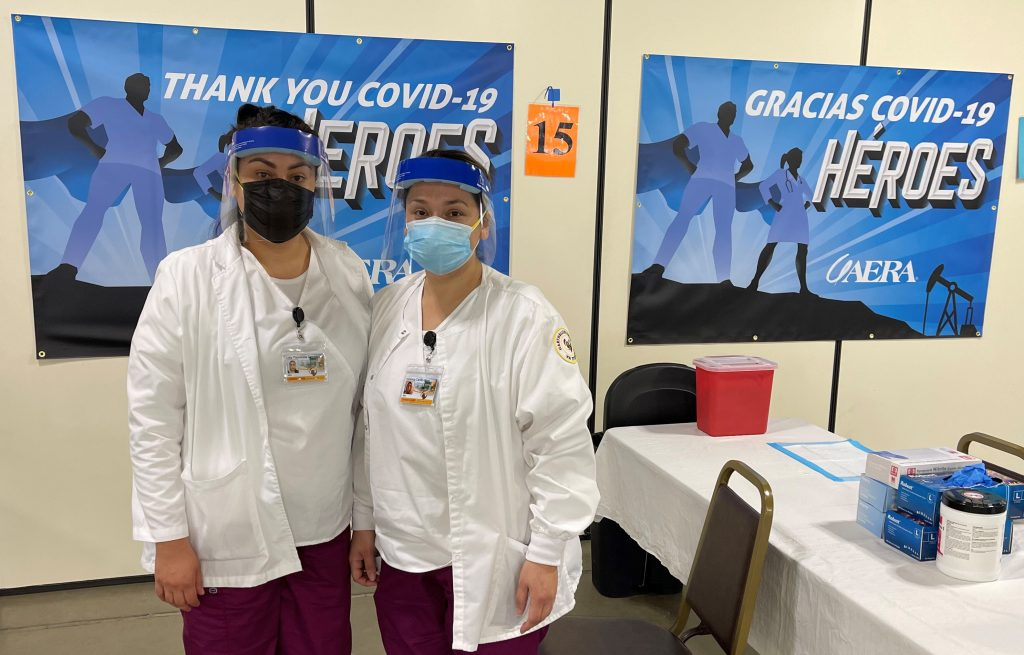 Two students from Hartnell College's nursing program assist at a Monterey County COVID-19 vaccination event for area farmworkers.