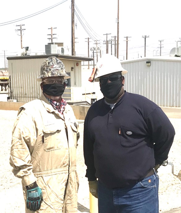 Manager of Operations John O'Connor, (left) and Reliability Specialist Dietrich Robertson don required personal protective face masks as a proactive measure to prevent the spread of COVID-19 in the Belridge Operations.