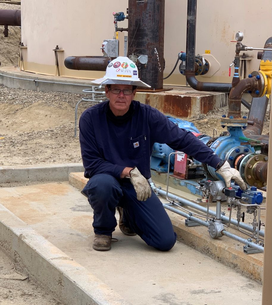 Mike Behrendt, a construction specialist at Aera-Ventura, shows how newly installed valves are used to conserve water during the filtration process.