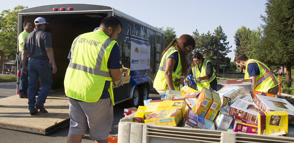 Aera volunteers sort food donations from the 2019 Oil Can Do It campaign.