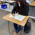 Alicia, a seventh grader at San Ardo School, writes a letter to her Aera pen pal.