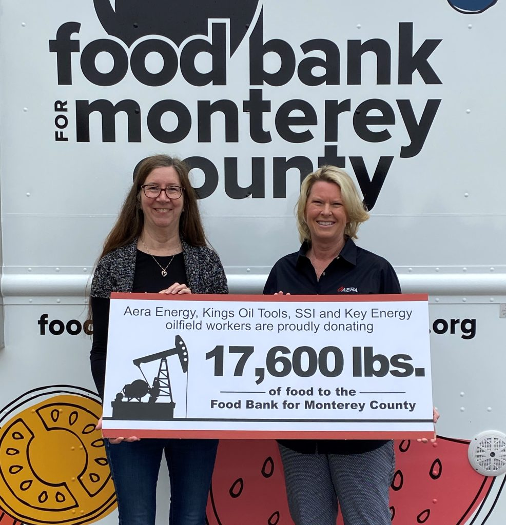 Cathleen Montero, (left) chief financial officer, Food Bank for Monterey County, and Kathy Miller, (right) Aera public affairs coordinator for Monterey County, pose for a photo.