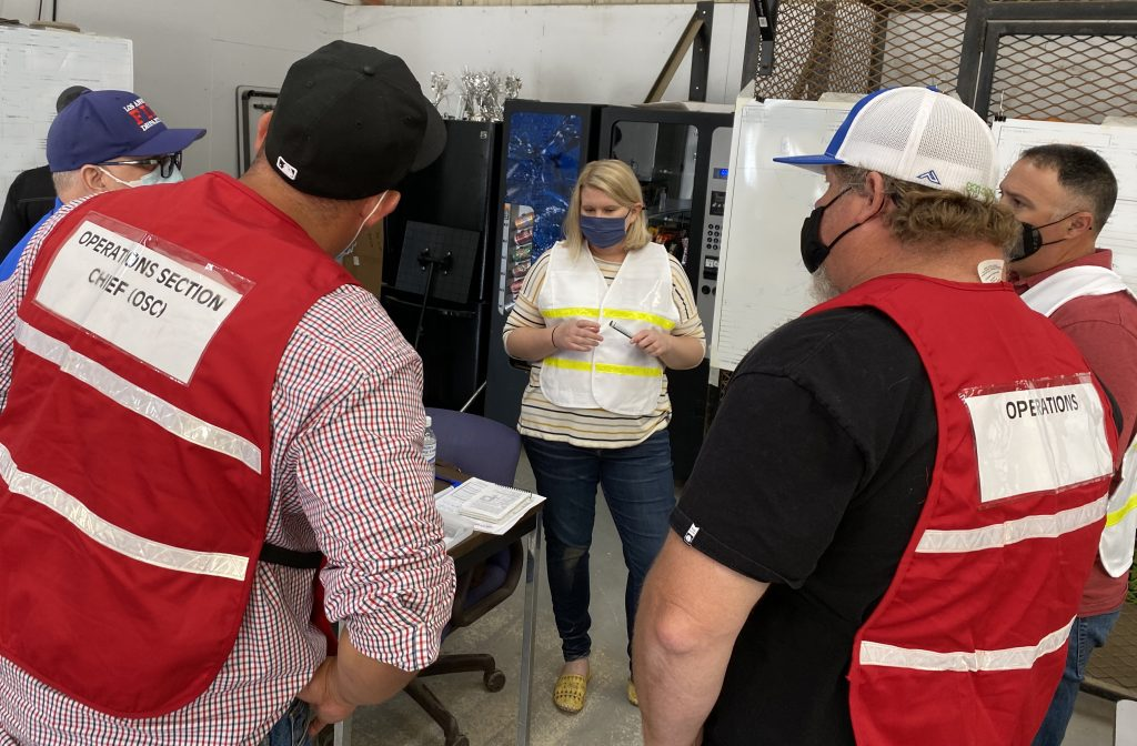 Ali Zauner, manager of operations for Aera's San Ardo and Coalinga fields, meets with members of Aera's incident command team during a recent emergency-preparedness drill in San Ardo.