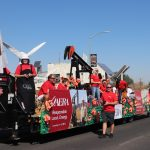 Aera employees proudly stand with the float they built for the Taft Oildorado Grand Parade. This was the first time Aera had a float in the parade.